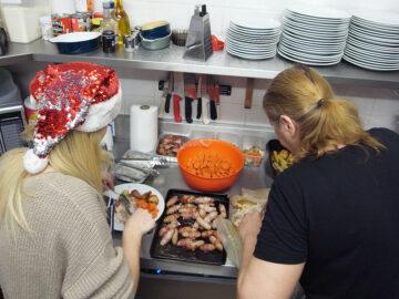 Staff prepare the main course